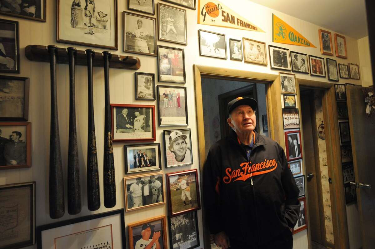 Former Giants player and manager Alvin Dark with some of his collected memorabilia at his home in Easley, South Carolina on Friday, January 6, 2012. Dark, who turns 90 on Jan. 7th., was also manager of the Oakland Athletics.