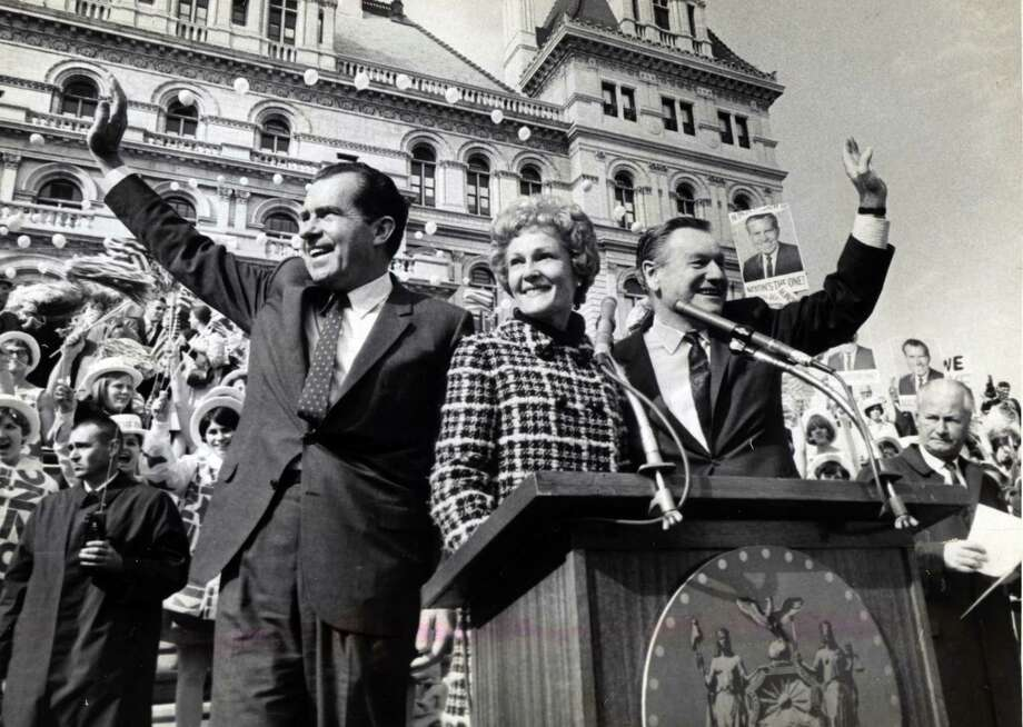 Richard Nixon, left, wife Pat, center, and Gov. Nelson Rockefeller, right, wave to supporters speaks during an October 1968, Nixon campaign stop at the Capitol in Albany, N.Y. (Bob Richey/Times Union archive)