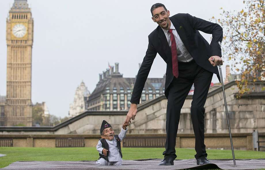 The long and the short of it: Chandra Bahadur Dangi, from Nepal, 21.5 inches tall, the shortest adult to have ever been verified by Guinness World Records, poses for pictures in London with the world's tallest man Sultan Kosen, 8 foot 3 inches, from Turkey. Photo: Andrew Cowie, AFP/Getty Images