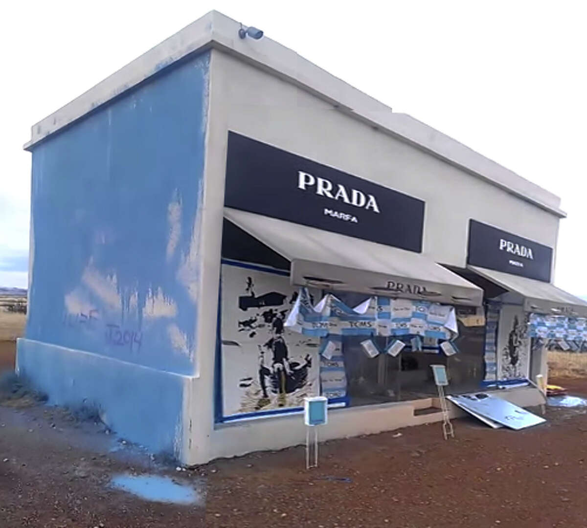 """A Texas artist has pleaded guilty to two counts of misdemeanor criminal mischief for vandalizing the famous Prada Marfa installation in Valentine. Joe Magnano, a 32-year-old man using the pseudonym """"927 1977,"""" will pay Ballroom Marfa, which maintains the structure, $10,700 to restore the piece and a $1,000 fine, Glasstire reported. He will also serve two years probation."""