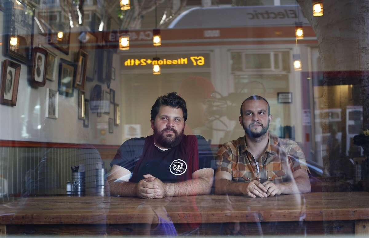 Owners of Wise Sons Jewish Delicatessen Evan Bloom and Leo Beckerman sit in the window of their 24th street restaurant on Thursday Sep. 11, 2014 in San Francisco, Calif.