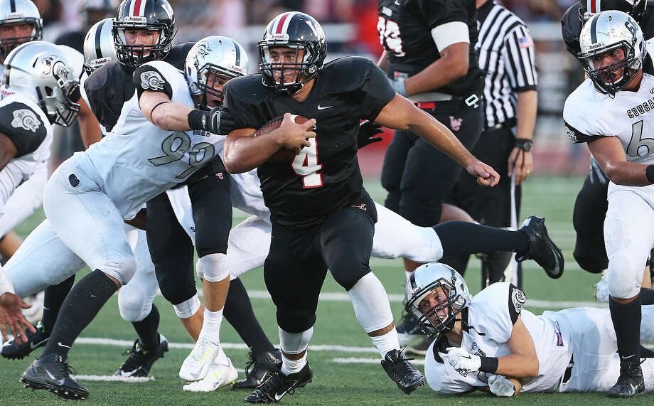 Nick Smisek breaks through the middle for Churchill against Clark in the Gucci Bowl at Comalander Stadium on Aug. 28, 2014. Photo: Tom Reel /San Antonio Express-News / San Antonio Express-News