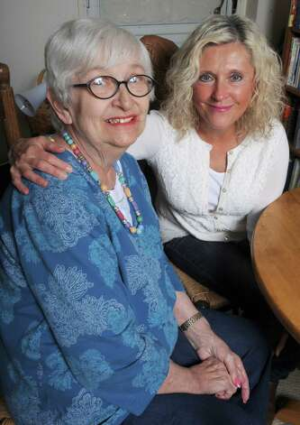 Peg Spain Murtagh, left,  wrote a book about Troy with her daughter Coleen Paratore on Friday Nov. 7 2014 in Troy, N.Y. (Michael P. Farrell/Times Union) ORG XMIT: MER2014111215014935 Photo: Michael P. Farrell / 00029398A