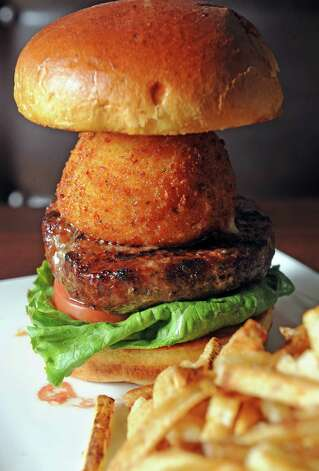 The mac and cheese burger at the City Line Bar and Grill on Friday Nov. 7, 2014 in Albany, N.Y. (Michael P. Farrell/Times Union) Photo: Michael P. Farrell / 00029355A