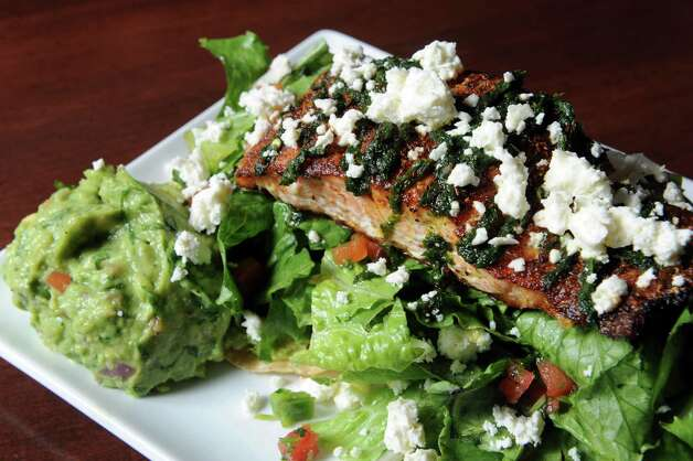 The salmon tostada at the City Line Bar and Grill on Friday Nov. 7, 2014 in Albany, N.Y. (Michael P. Farrell/Times Union) Photo: Michael P. Farrell / 00029355A