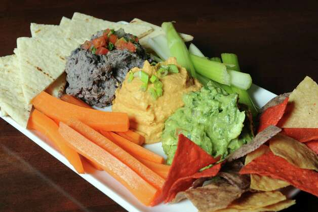 The Trio spread w Buffalo hummus, Guacamole and black bean hummus at the City Line Bar and Grill on Friday Nov. 7, 2014 in Albany, N.Y. (Michael P. Farrell/Times Union) Photo: Michael P. Farrell / 00029355A