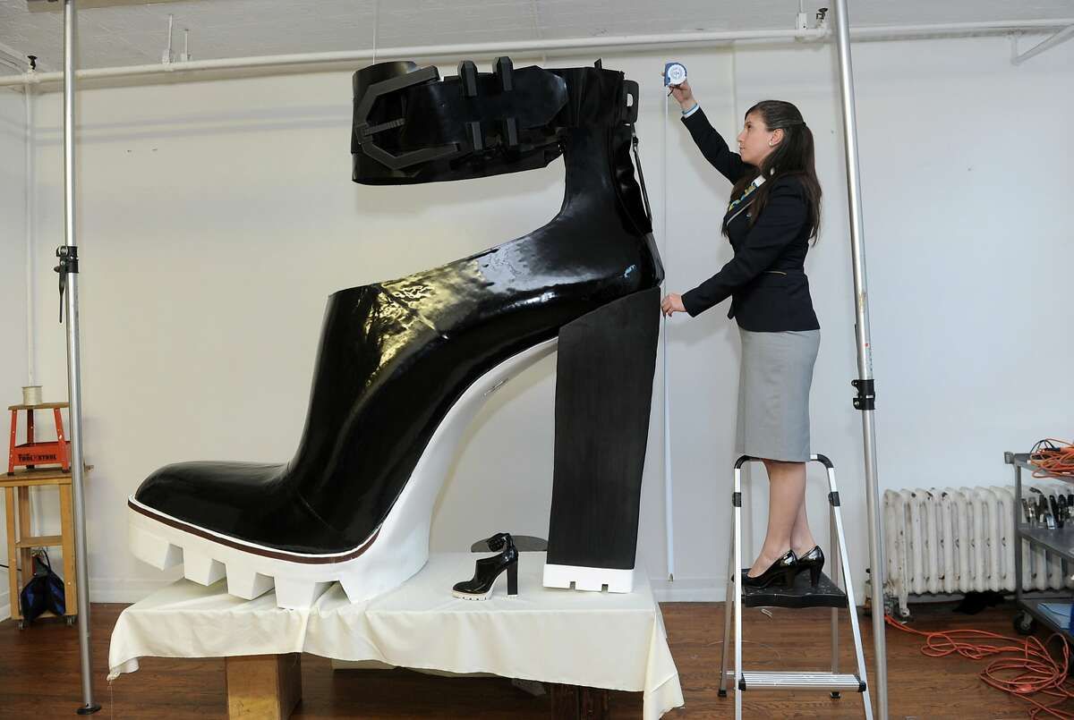 What would happen if Kim Kardashian wore this shoe?  Guinness World Records adjudicator Kim Partrick measures the largest high-heeled shoe, standing 6 feet 1 inch tall and 6 feet 5 inches long, in New York. The shoe was created by Jill Martin and Kenneth Cole as part of Guinness World Records Day.