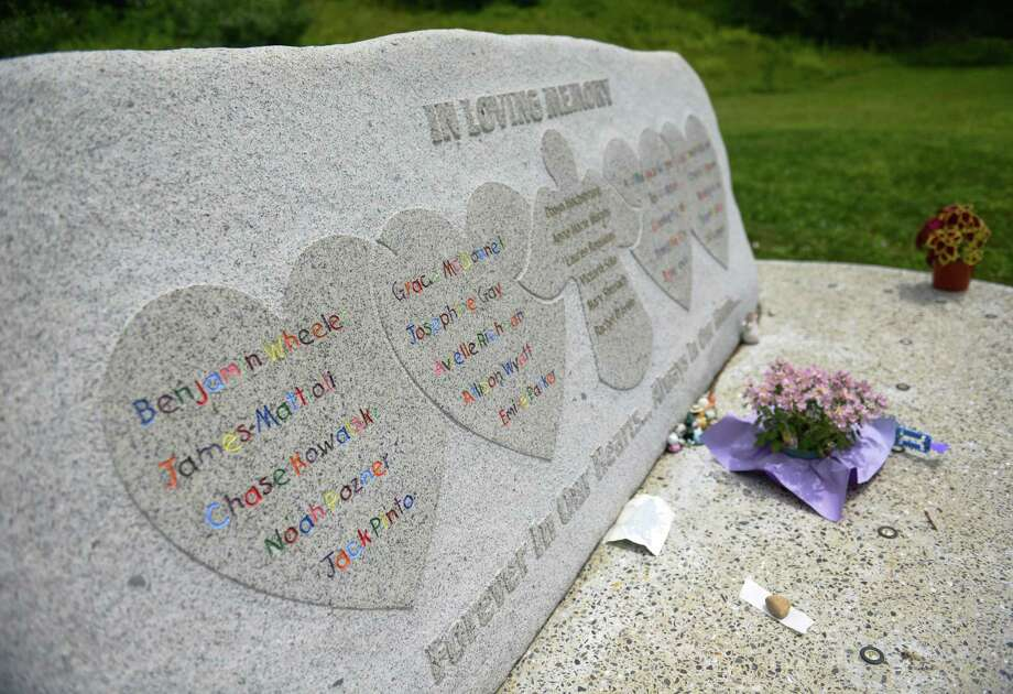 A private memorial for the victims of the Sandy Hook Elementary School shooting on Dec. 14, 2012 sits behind St. John's Episcopal Church in Sandy Hook, Conn. Thursday, July 24, 2014.  The Newtown Permanent Memorial Commission is considering a public memorial that would reflect the wishes of the families and those closest to the tragedy as well as the general community. Photo: Tyler Sizemore / The News-Times