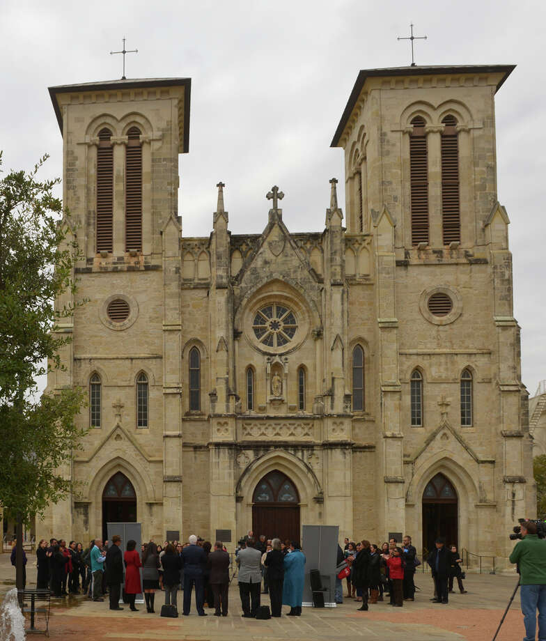 Local officials held a news conference Wednesday at the Main Plaza in front of San Fernando Cathedral to announce 2015 enrollment efforts. The goal is to sign up an additional 47,000 Bexar County residents by the Feb. 15 deadline. Enrollment starts Saturday. Photo: Robin Jerstad, Freelance