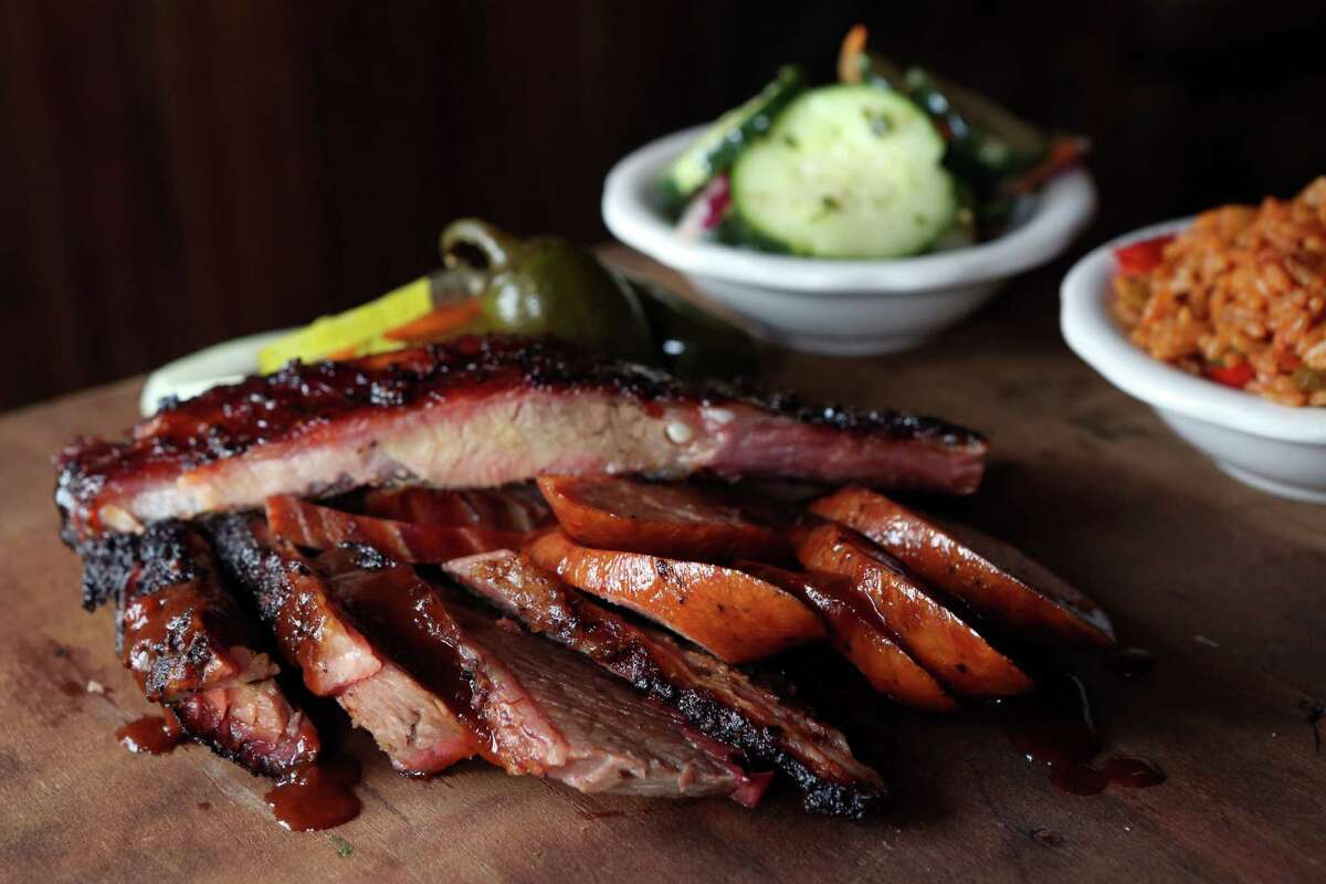 House Special includes pork ribs, beef brisket, ham, pork sausage, spicy rice, and cucumber salad at Pappas Barbecue Restaurant on Friday, Oct. 10, 2014, in Houston. ( Mayra Beltran / Houston Chronicle )