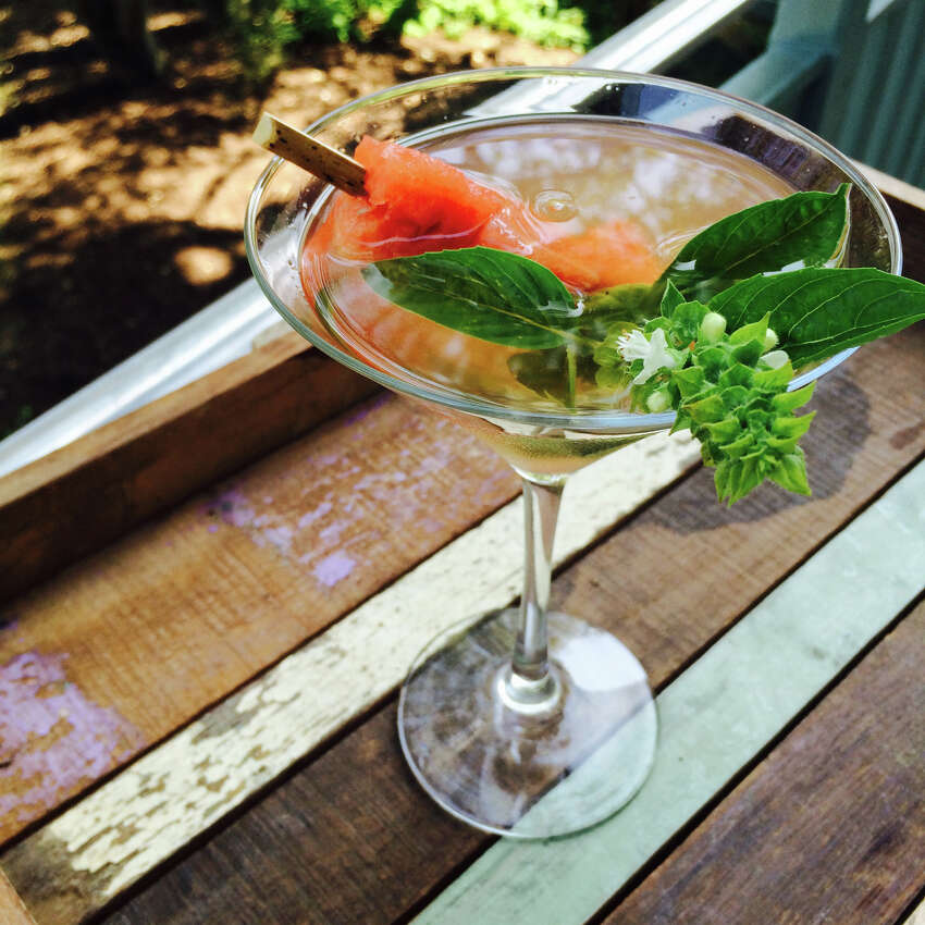 MISTLETOE MARTINI: Tito's watermelon-infused vodka martini garnished with basil leaf from the resort's herb garden.