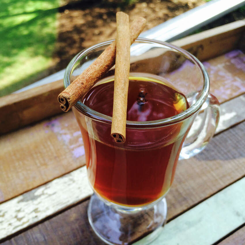BUTTER ME UP: 1 part Spiced Rum, a pinch of brown sugar, a pinch of cinnamon, a pinch nutmeg, a pinch of salt, ½ teaspoon unsalted butter, ½ teaspoon of honey, 2 cloves, topped with boiling water garnished with cinnamon sticks.