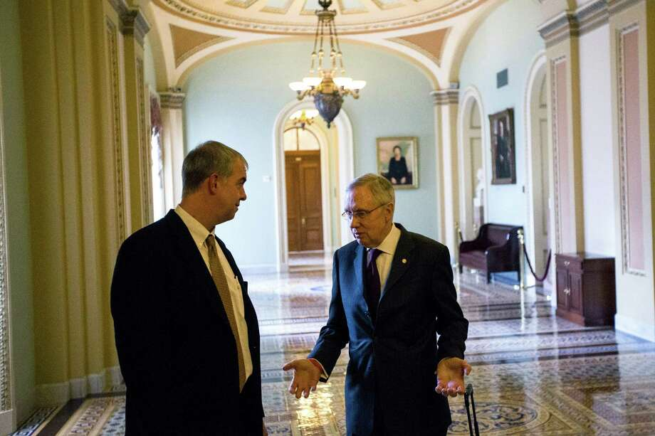 Senate Majority Leader Harry Reid (D-Nev.), right, speaks with Don Stewart, the press secretary of Senate Minority Leader Mitch McConnell (R-Ky.), on Capitol Hill. In the aftermath of the recent elections, McConnell will become the majority leader in January, and one of our readers is rejoicing in the restructuring of the Senate hiearchy. Photo: JABIN BOTSFORD / JABIN BOTSFORD / New York Times / NYTNS