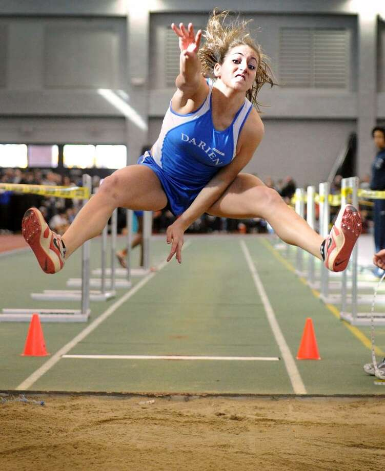 Darien's Christy Gasparino competes in the long jump Saturday Feb. 20, 2010 at the CIAC State Championship Indoor Track and Field meet at the New Haven Athletic Center. Photo: Autumn Driscoll / Connecticut Post