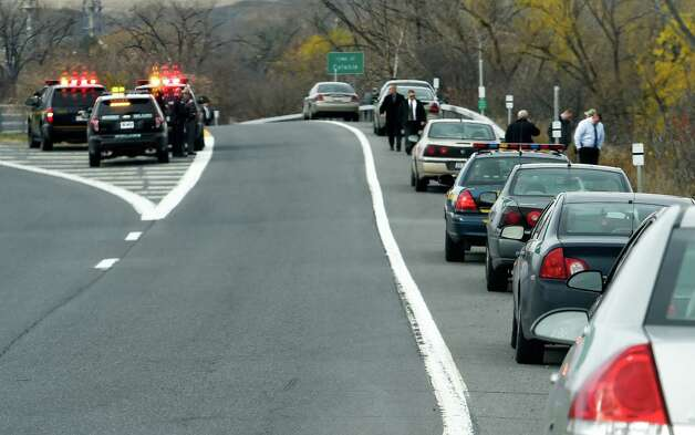 State and local law enforcement line the western lanes of northbound ramp from Route 7 to I-787 searching for evidence of a shooting incident involving two dark colored Honda cars Thursday afternoon, Nov. 13, 2014, in Colonie, N.Y.  (Skip Dickstein/Times Union) Photo: SKIP DICKSTEIN