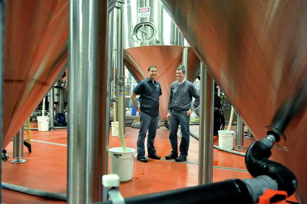 Jeremy Cowan, left, owner of Shmaltz Brewing Company and Jeff Vukelic, president of Saratoga Eagle, pose for a photograph inside the brewery on Thursday, Nov. 13, 2014, in Clifton Park, N.Y.  (Paul Buckowski / Times Union) Photo: Paul Buckowski / 00029453A