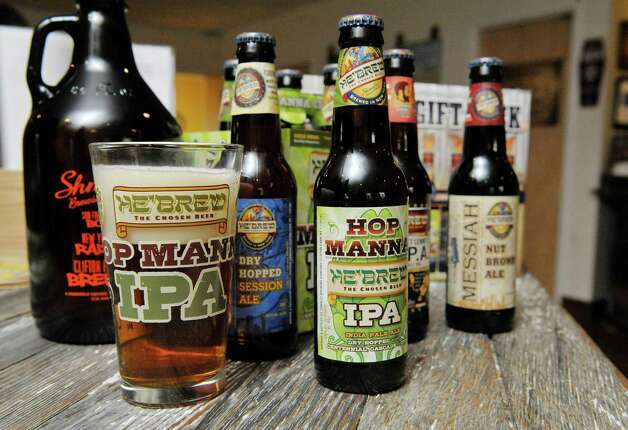 A view of some of the beers brewed at the  Shmaltz Brewing Company, seen here on Thursday, Nov. 13, 2014, in Clifton Park, N.Y.   The Hop Manna IPA is the newest beer being made by the brewery.  (Paul Buckowski / Times Union) Photo: Paul Buckowski / 00029453A