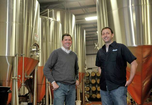 Jeff Vukelic, left,  president of Saratoga Eagle and Jeremy Cowan, owner of Shmaltz Brewing Company,  pose for a photograph inside the brewery on Thursday, Nov. 13, 2014, in Clifton Park, N.Y.  (Paul Buckowski / Times Union) Photo: Paul Buckowski / 00029453A