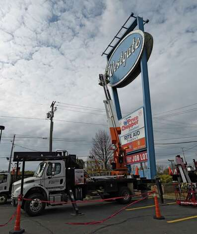 The sign in front of the Westgate Shopping Center is being dismantled for renovation Thursday afternoon Nov. 13, 2014 in Albany, N.Y.    (Skip Dickstein/Times Union) Photo: SKIP DICKSTEIN / 00029464A