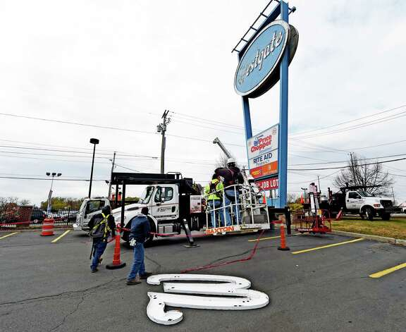 The W from the sign in front of the Westgate Shopping Center lays in the parking lot Thursday afternoon Nov. 13, 2014 in Albany, N.Y.  The landmark sign is being dismantled for renovation.   (Skip Dickstein/Times Union) Photo: SKIP DICKSTEIN / 00029464A