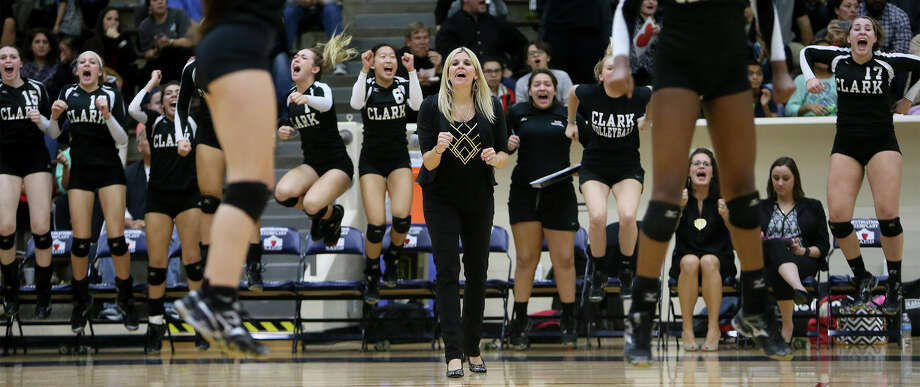 Clark volleyball coach Kristen Daniell (center) cheers with the Lady Cougars from the bench during their Class 6A regional quarterfinals match with New Braunfels Canyon at Alamo Convocation Center on Tuesday, Nov. 11, 2014.  Clark beat Canyon in four sets: 25-18, 20-25, 26-24 and 25-13.  MARVIN PFEIFFER/ mpfeiffer@express-news.net Photo: Marvin Pfeiffer, Staff / San Antonio Express-News / Express-News 2014