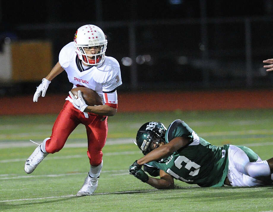 Scenes from the high school football game between Norwalk High School and Greenwich High School at Norwalk, Friday night, Oct. 10, 2014. Greenwich defeated Norwalk, 14-7. GHS #3 Austin Longi   NHS #13 Dariius Barrett Photo: Bob Luckey / Greenwich Time