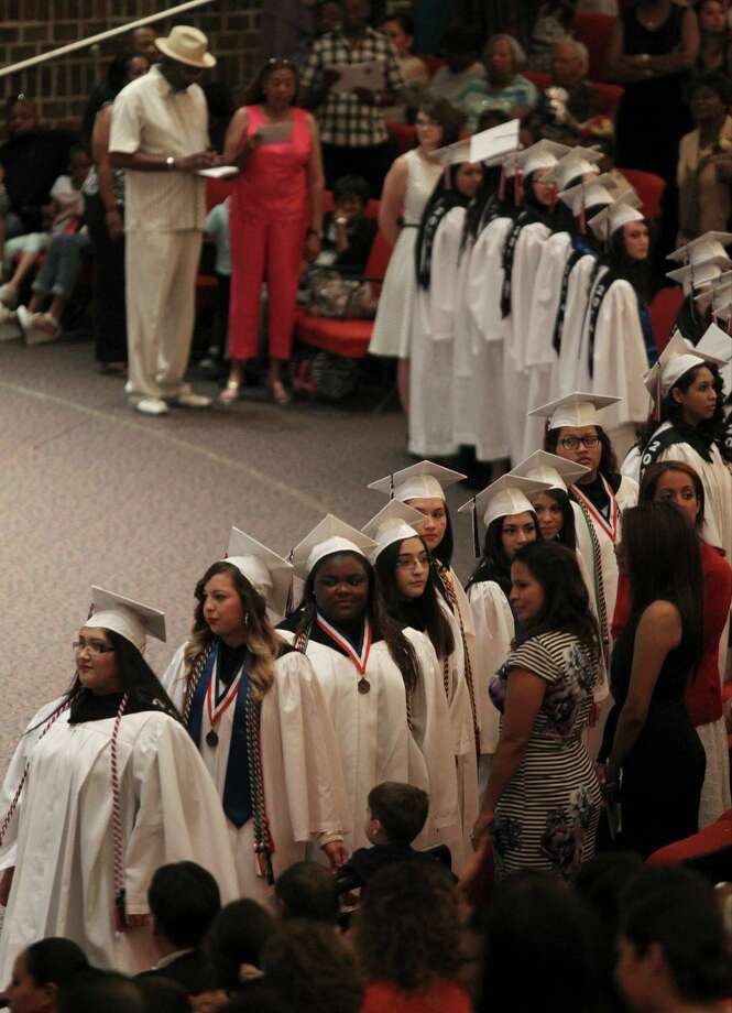 Texas is losing far too many students before they graduate from high school. Here, members of the first high school graduating class of the Young Women's Leadership Academy prepare to take their seats at their commencement ceremony on Saturday, June 7, 2014, at Laurie Auditorium on the Trinity University campus in San Antonio. Photo: Timothy Tai / Timothy Tai / San Antonio Express-News / © 2014 San Antonio Express-News