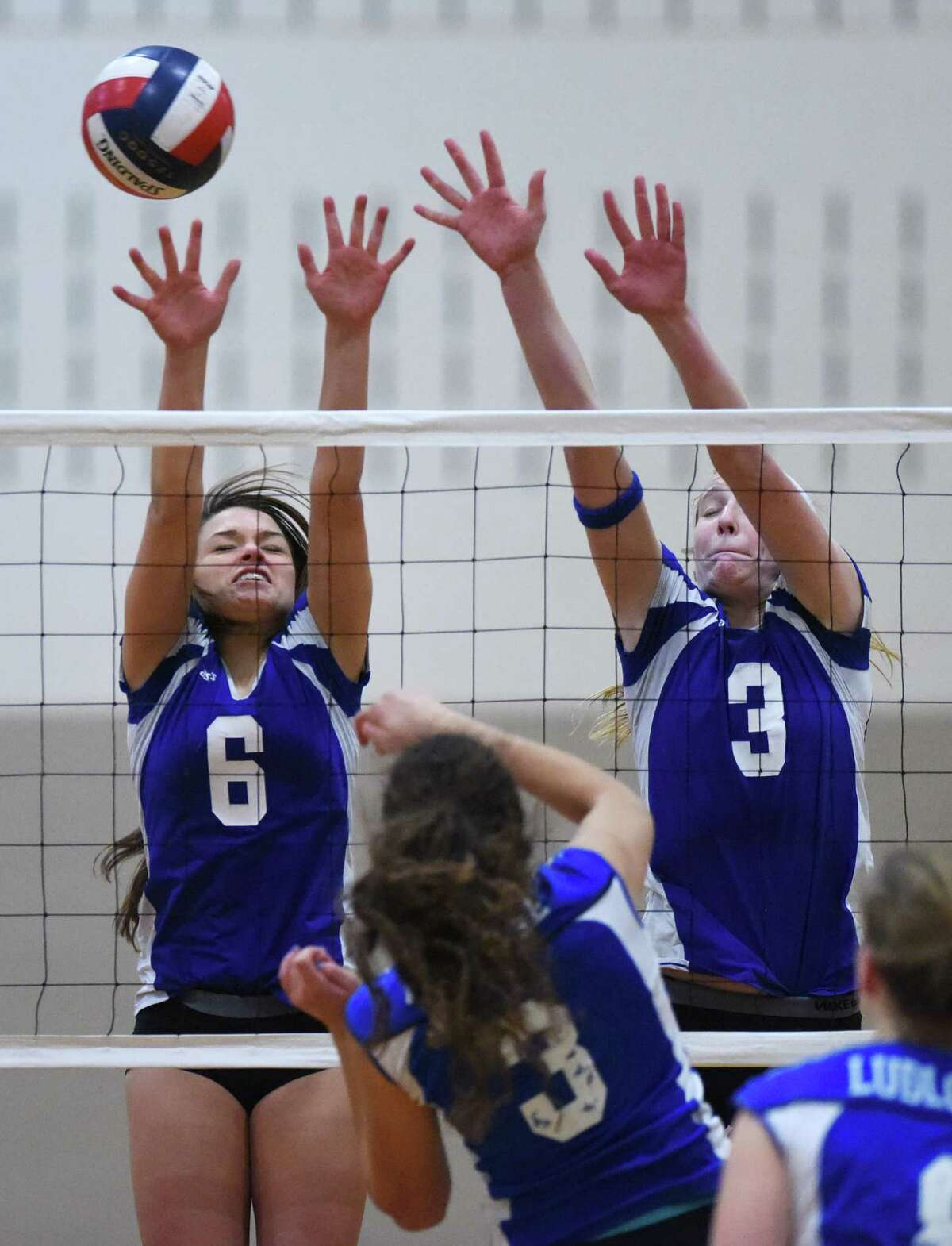 Darien's Samantha Huff, left, and Isabelle Taylor go up for a block in Darien's 3-1 (23-25, 25-16, 25-12, 25-16) win over Fairfield Ludlowe in the CIAC Class LL girls volleyball semifinal game at Shelton Intermediate School in Shelton, Conn. Thursday, Nov. 13, 2014.