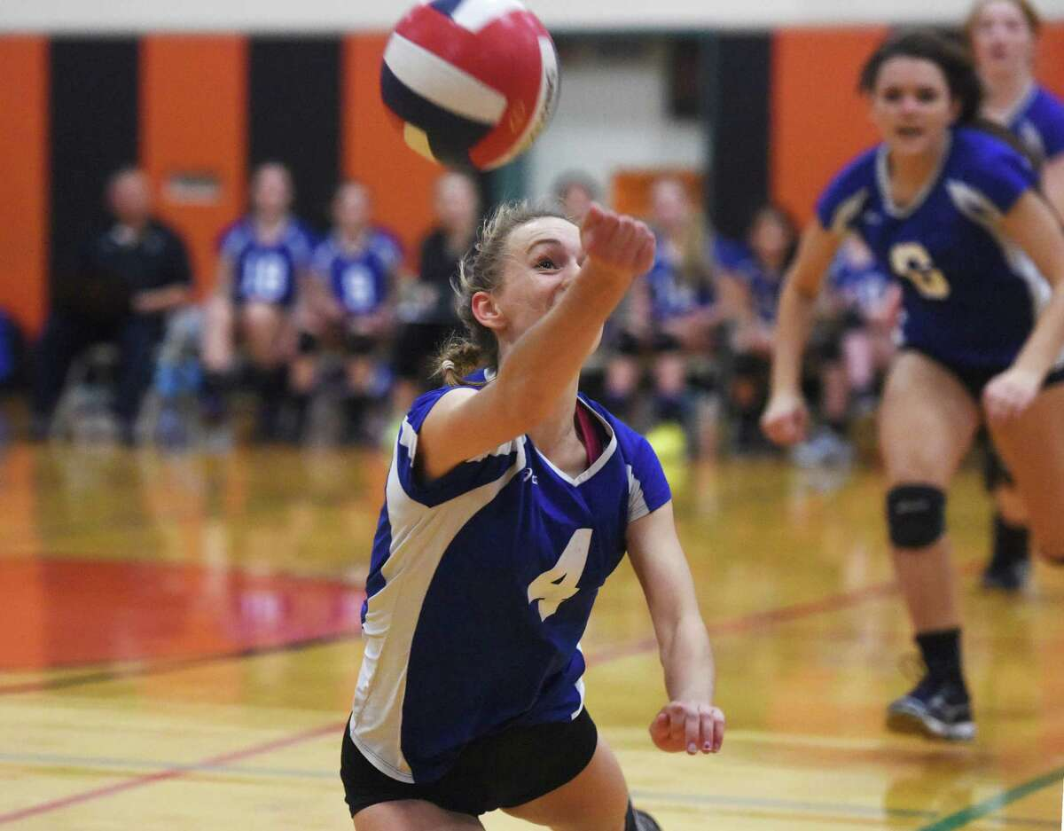 Darien's Emily Milukas makes a one-handed save in Darien's 3-1 (23-25, 25-16, 25-12, 25-16) win over Fairfield Ludlowe in the CIAC Class LL girls volleyball semifinal game at Shelton Intermediate School in Shelton, Conn. Thursday, Nov. 13, 2014.