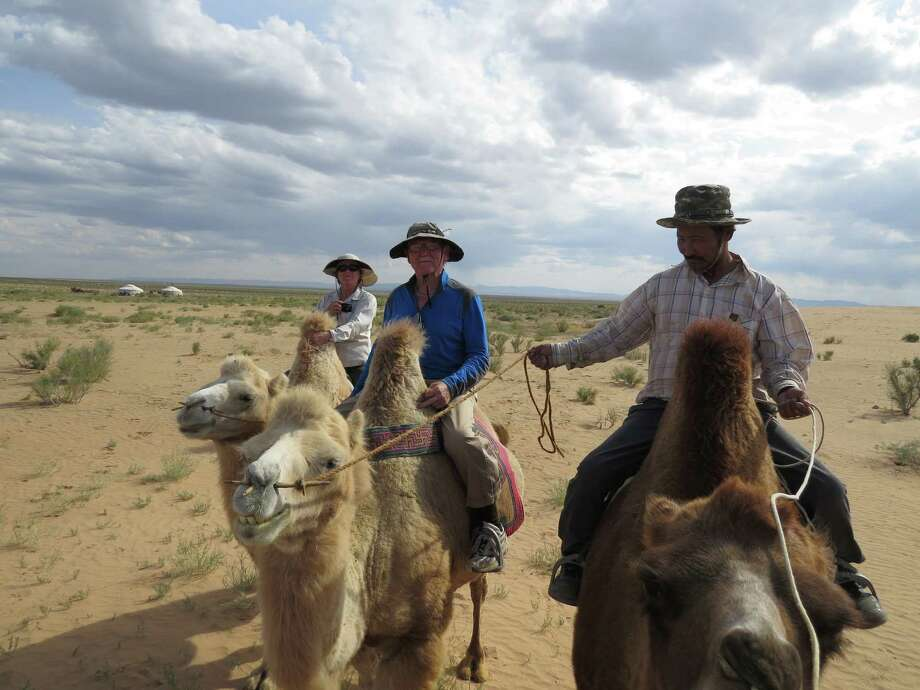 Joan Watson of Mill Valley rides camels in Mongolia. / ONLINE_YES