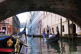 Splurging on a gondola ride in Venice — about $160 for 50 minutes — will buy you a memory for a lifetime.