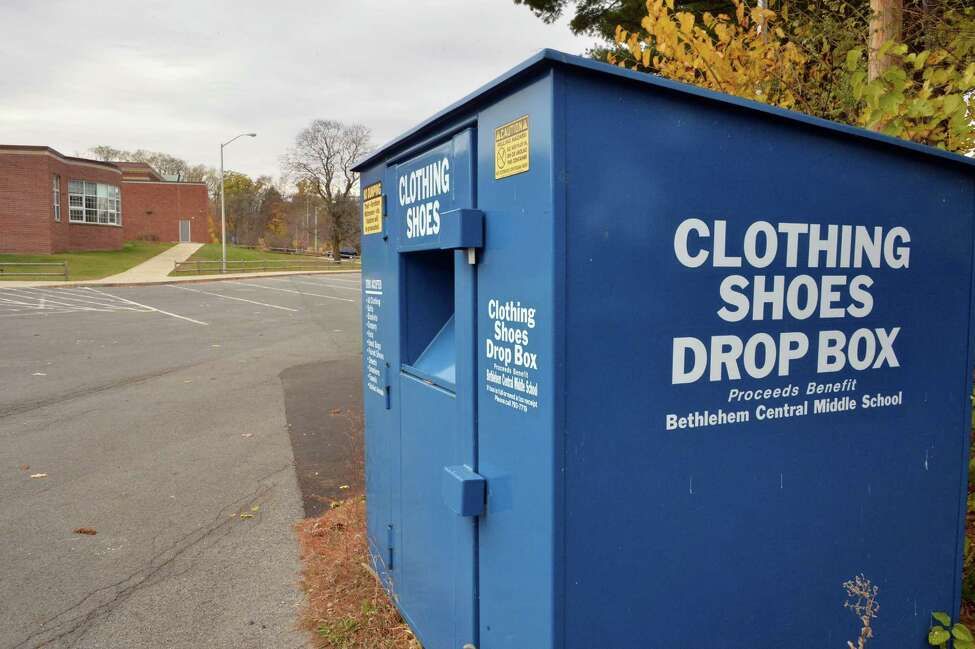 A metal bin that accepts textile donations at Bethlehem Central Middle School Thursday Nov. 13, 2014, in Delmar, NY. Bethlehem will collect used textiles Saturday to celebrate America Recycles Day and the launch of Clothes the Loop NY. (John Carl D'Annibale / Times Union)