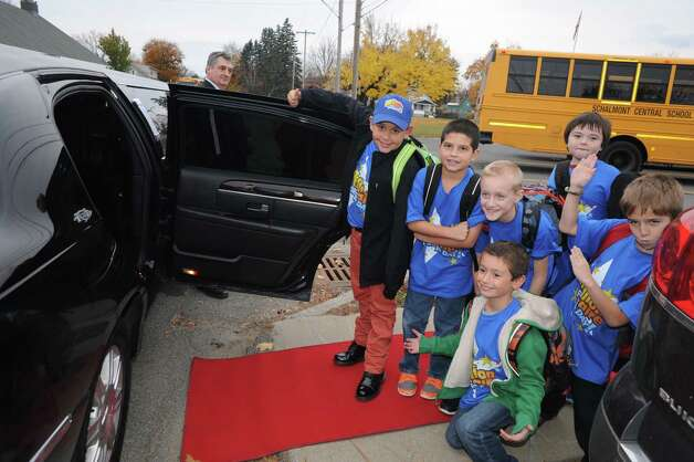 Nikos Johnson, far left, a third grade student at Jefferson Elementary School gets picked up from school by limo with five of his friends after winning the First New York Federal Credit Union's Millionaire for the Day on Thursday Nov. 13, 2014 in Rotterdam, N.Y. First New York Federal Credit Union has been teaching thousands of area students for years to save their money through its KID$ (Keep Investing Dollars Savings) Program. To celebrate the studentsa€™ success, the credit union randomly selected a school banker to be treated like a Millionaire. As the Millionaire for the Day, Nikos Johnson and his classmates will be treated to a waiter-served lunch. In addition, Nikos and five of his friends will be picked up from Jefferson Elementary School at dismissal time and the red carpet will be rolled out treating them to a limousine ride to First New York Federal Credit Uniona€™s headquarters at 2 Wall Street, Albany where they will meet the President/CEO, Lucy Halstead and members of the Board of Directors, receive a personal tour of the credit union and return home via limousine at the end of the day. Mr. Joby Gifford, Principal at Jefferson Elementary School. Nikos, like many other students at Jefferson Elementary School make deposits each week from money they have earned by doing chores, receiving allowance and birthday money. Some students deposit money into their savings account from the soda bottles they help return, while others often find money on the ground. (Michael P. Farrell/Times Union) Photo: Michael P. Farrell / 00029474A