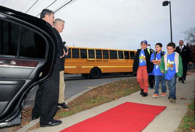Nikos Johnson, left in group of boys, a third grade student at Jefferson Elementary School gets picked up from school by limo with five of his friends after winning the First New York Federal Credit Union's Millionaire for the Day on Thursday Nov. 13, 2014 in Rotterdam, N.Y. First New York Federal Credit Union has been teaching thousands of area students for years to save their money through its KID$ (Keep Investing Dollars Savings) Program. To celebrate the studentsa€™ success, the credit union randomly selected a school banker to be treated like a Millionaire. As the Millionaire for the Day, Nikos Johnson and his classmates will be treated to a waiter-served lunch. In addition, Nikos and five of his friends will be picked up from Jefferson Elementary School at dismissal time and the red carpet will be rolled out treating them to a limousine ride to First New York Federal Credit Uniona€™s headquarters at 2 Wall Street, Albany where they will meet the President/CEO, Lucy Halstead and members of the Board of Directors, receive a personal tour of the credit union and return home via limousine at the end of the day. Mr. Joby Gifford, Principal at Jefferson Elementary School. Nikos, like many other students at Jefferson Elementary School make deposits each week from money they have earned by doing chores, receiving allowance and birthday money. Some students deposit money into their savings account from the soda bottles they help return, while others often find money on the ground. (Michael P. Farrell/Times Union) Photo: Michael P. Farrell / 00029474A
