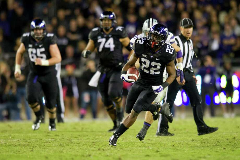 TCU's Aaron Green, of local Madison High School, breaks free against the Kansas State Wildcats during the 3rd quarter on November 8. Photo: Cooper Neill / Cooper Neill / Getty Images / 2014 Getty Images