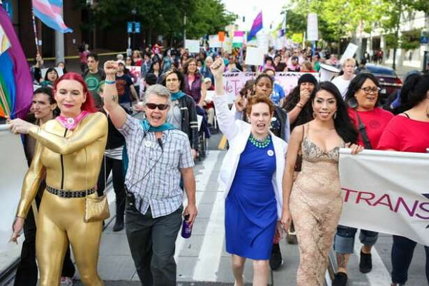 Marchers make their way down Broadway as part of the Trans* Pride Seattle 2014 march and celebration. (Joshua Bessex, seattlepi.com)