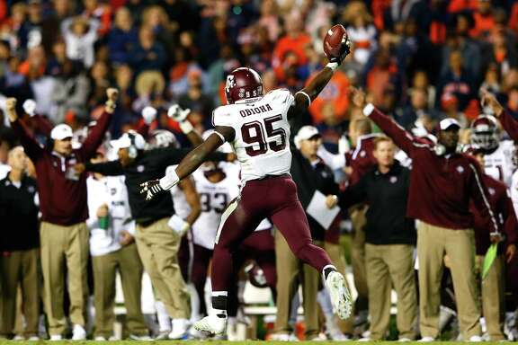 Texas A&M defensive end Julien Obioha recovered a fumble in the waning minutes to help the Aggies pull off a 41-38 upset at Auburn this past Saturday.