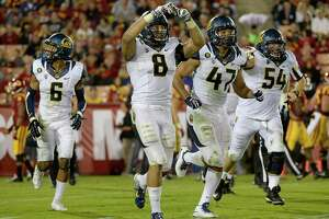 Cal defense gears up to stop run against Stanford - Photo