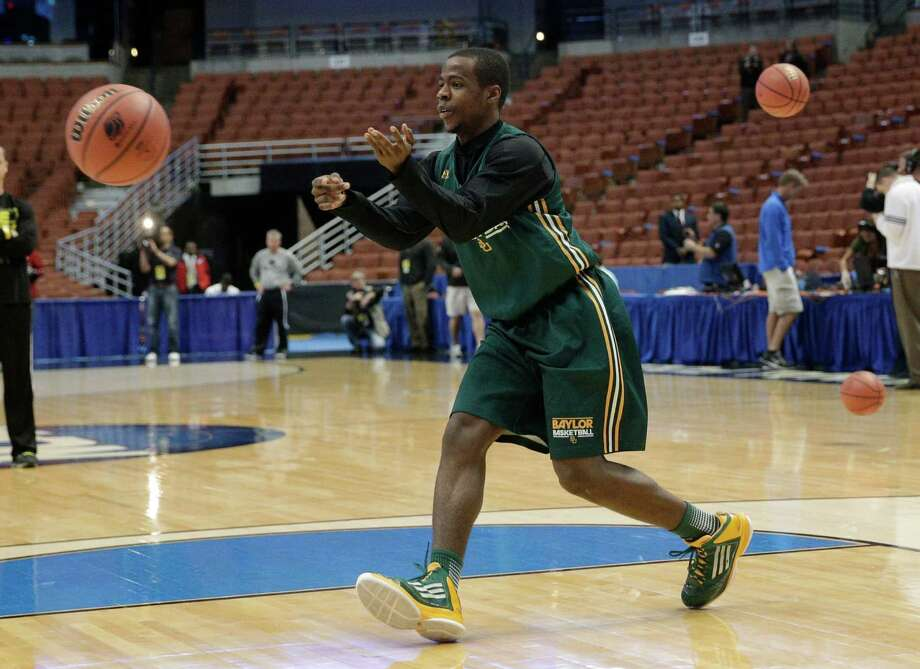 Baylor's Kenny Chery passes the ball during practice at the NCAA college basketball tournament Wednesday, March 26, 2014, in Anaheim, Calif. Baylor plays Wisconsin in a regional semifinal on Thursday. (AP Photo/Jae C. Hong) Photo: Jae C. Hong, STF / Associated Press / AP