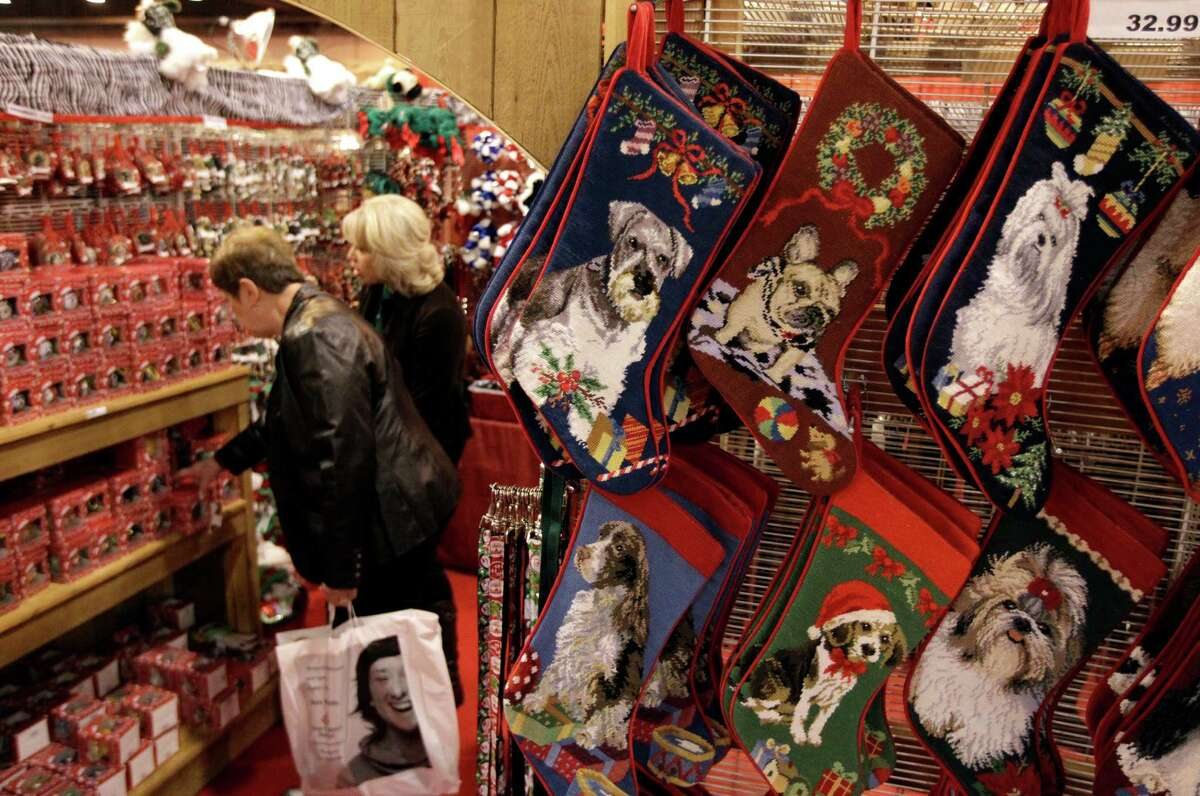 Dog Christmas stockings are displayed at the Crafty Canine booth during the Nutcracker Market at NRG Center, Thursday, Nov. 13, 2014, in Houston.