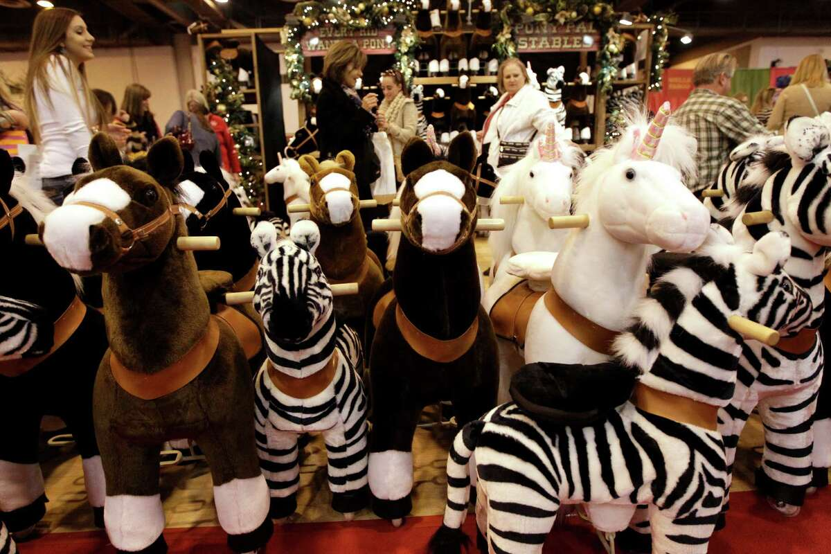 Ponies, zebras, and unicorns are on display at the Pony Pal Stables booth during the Nutcracker Market at NRG Center, Thursday, Nov. 13, 2014, in Houston.