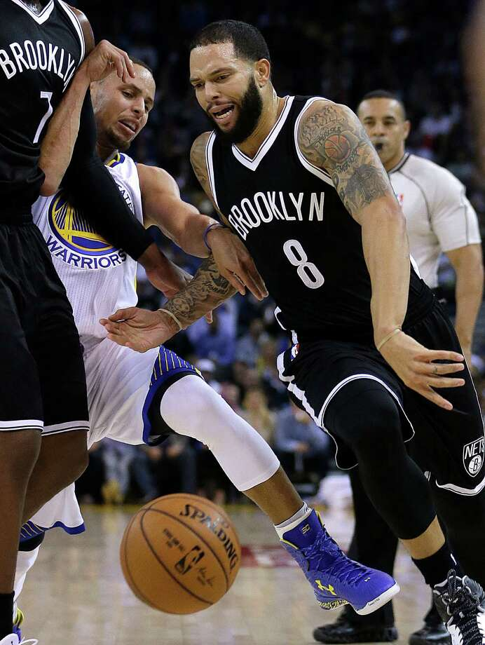 Brooklyn Nets' Deron Williams (8) drives the ball past Golden State Warriors' Stephen Curry during the first half of an NBA basketball game Thursday, Nov. 13, 2014, in Oakland, Calif. (AP Photo/Ben Margot) Photo: Ben Margot / Associated Press / AP