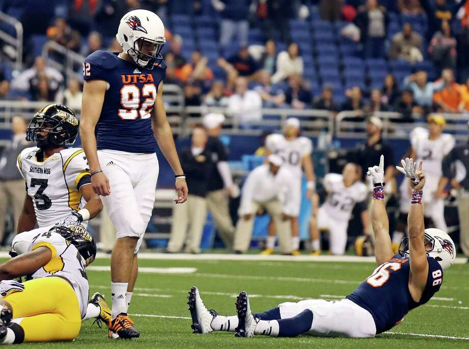 UTSA's Sean Ianno and Seth Grubb react after Ianno's game winning field goal late in the game with Southern Mississippi. The Roadrunners won 12-10. Photo: Edward A. Ornelas, Staff / San Antonio Express-News / © 2014 San Antonio Express-News