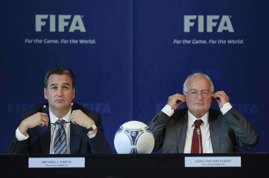 (FILES) A file picture taken on July 27, 2012 shows Michael J Garcia (L), Chairman of the investigatory chamber of the FIFA Ethics Committee, and Hans-Joachim Eckert (R), Chairman of the adjudicatory chamber of the FIFA Ethics Committee taking part in a press conference at FIFA headquarters in Zurich. A 42-page report, released by German judge Hans-Joachim Eckert on November 13, 2014 after an extensive investigation into the World Cup bidding process by American lawyer Michael Garcia has cleared 2022 World Cup hosts Qatar of corruption and ruled out a re-vote to decide the host of the competition despite widespread allegations of wrongdoing. AFP PHOTO / SEBASTIEN BOZONSEBASTIEN BOZON/AFP/Getty Images Photo: SEBASTIEN BOZON / AFP/Getty Images / AFP