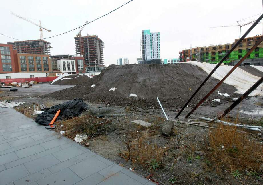 Mounds of dirt fill a vacant lot at 1300 Fourth St. in the Mission Bay neighborhood in San Francisco . The Tenderloin Neighborhood Development Corporation   received the green light to build 135 affordable housing units on the property. Photo: Paul Chinn / The Chronicle / ONLINE_YES