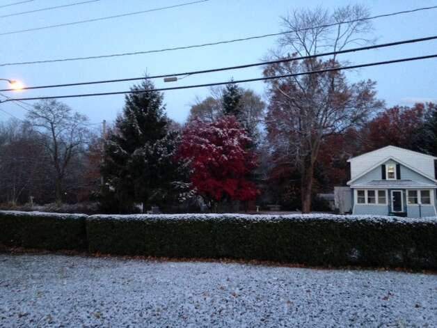A light coat of snow covers the ground on Lincoln Avenue in Colonie on Friday, Nov. 14, 2014. (Sarah Diodato / Times Union)