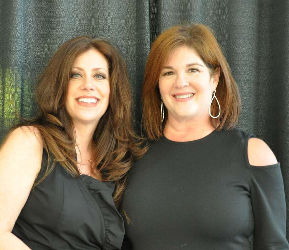 Emery/Weiner School auction co-chairs Elise Niefield (left), agent with Greenwood King Properties; and Dana Lepow.
