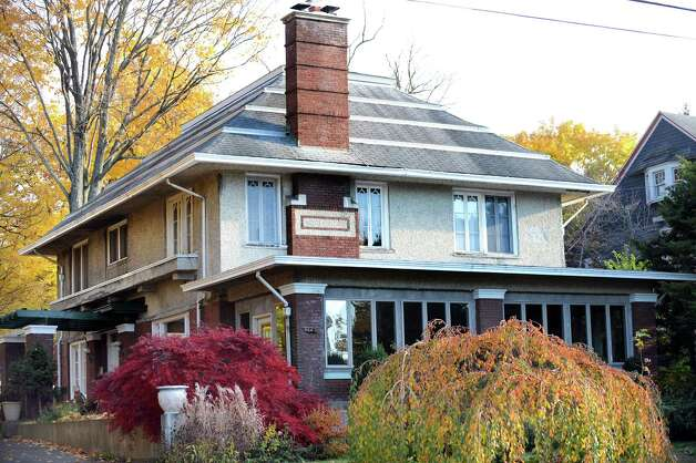 The house at 34 Myrtle Ave., Troy, is an example of Craftsman architecture, which became popular between 1905 and 1930. It is marked by a low-pitched roof, a long eave overhang and columns from the ground level to the porch roof.   (Cindy Schultz / Times Union) Photo: Cindy Schultz / 00029364A