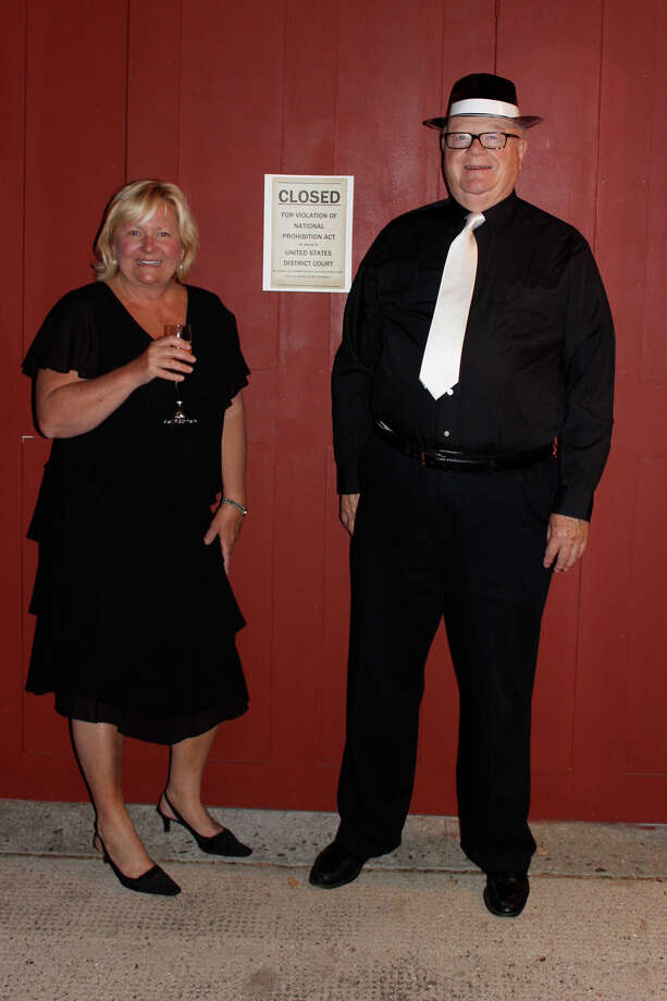 "Ridgefield residents Hilary Micalizzi and Joel Third were among those who knew the secret password to get into ""Cass Gilbert's Speakeasy of the'20s,"" a social gathering held earlier this fall at Keeler Tavern Museum, as part of Ridgefield's The Big Read. The event was among more than two dozen programs surrounding the 1925 classic ""The Great Gatsby,"" and the life and times of its author, F. Scott Fitzgerald. Photo: Contributed Photo / The News-Times Contributed"