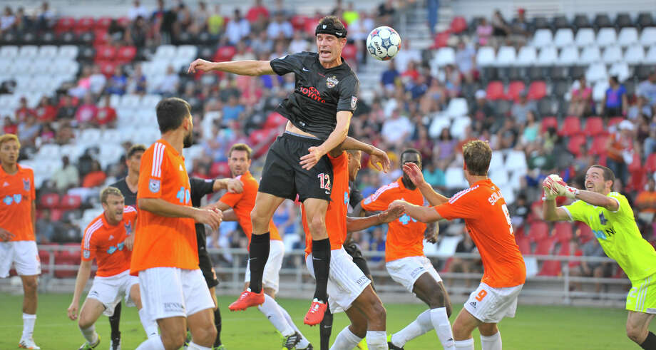 Greg Janicki, heading the ball against Carolina earlier this season, believes the Scorpions might be a team of destiny. Photo: Robin Jerstad, Freelancer / For The Express-News / San Antonio Express-News
